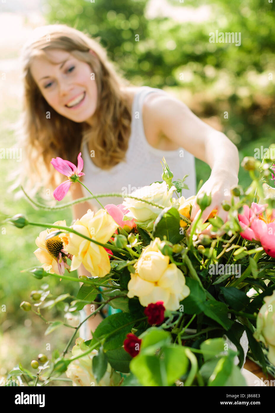 wedding, decoration, floral design, applied arts concept - in foreground beautiful bouquet composed of yellow roses, - Stock Image