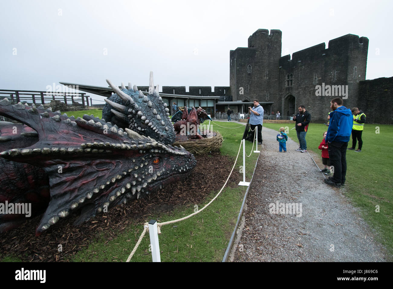 Caerphilly Castle, South Wales, UK.  27 May 2017. 2 new additions have been made to the dragon sculpture displays - Stock Image