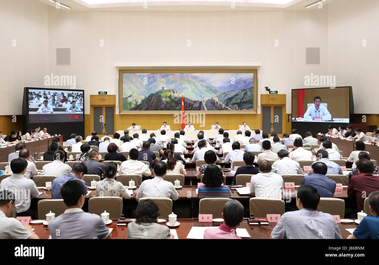 Beijing, China. 26th May, 2017. Chinese State Councilor Wang Yong speaks at a tele-conference on integrating separate - Stock Image