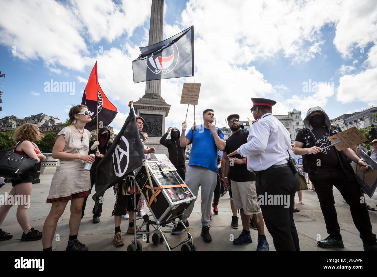 London, UK. 27th May, 2017. A small group of anti-fascists and anarchists march through Whitehall as part of an Stock Photo