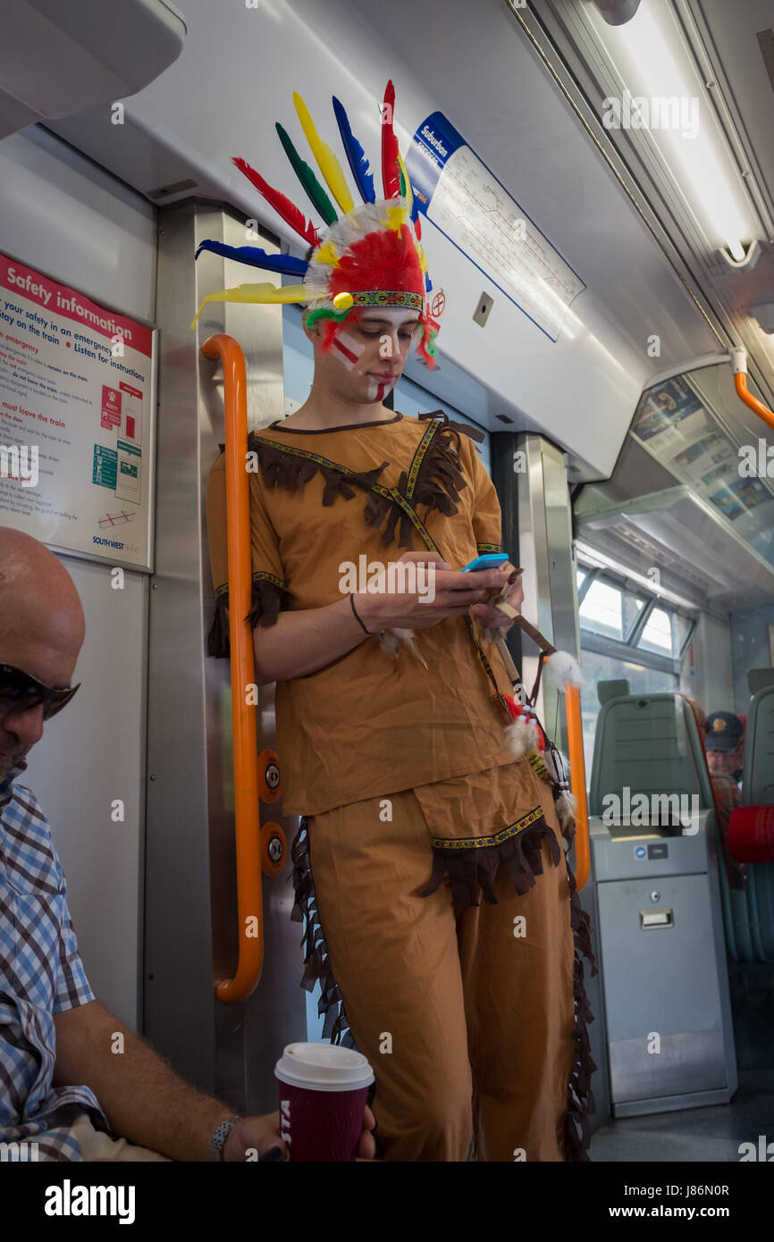 Twickenham, UK. 27th May, 2017. A fan looking incongruous among weekend travellers on the train to to the Aviva - Stock Image