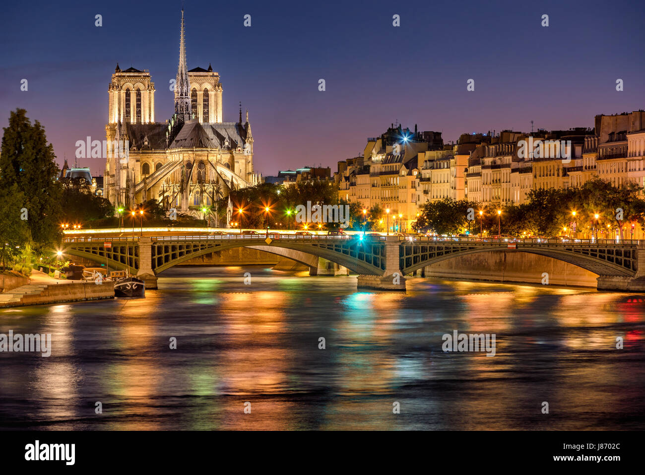Notre Dame de Paris Cathedral, Seine River and the Sully Bridge at twilight. Summer evening on Ile Saint Louis, - Stock Image