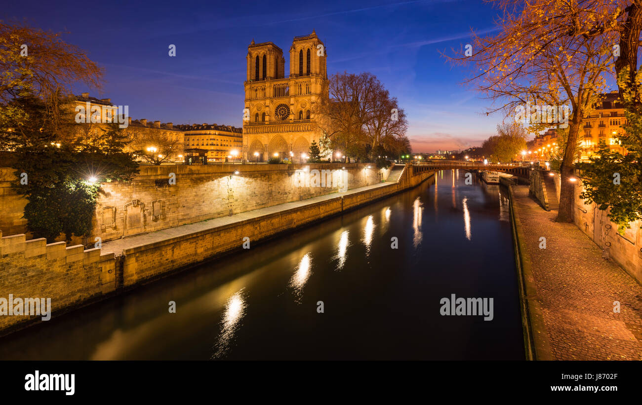 Notre Dame de Paris cathedral on Ile de La Cite at dawn with the Seine River. Daybreak in the 4th Arrondissement, - Stock Image