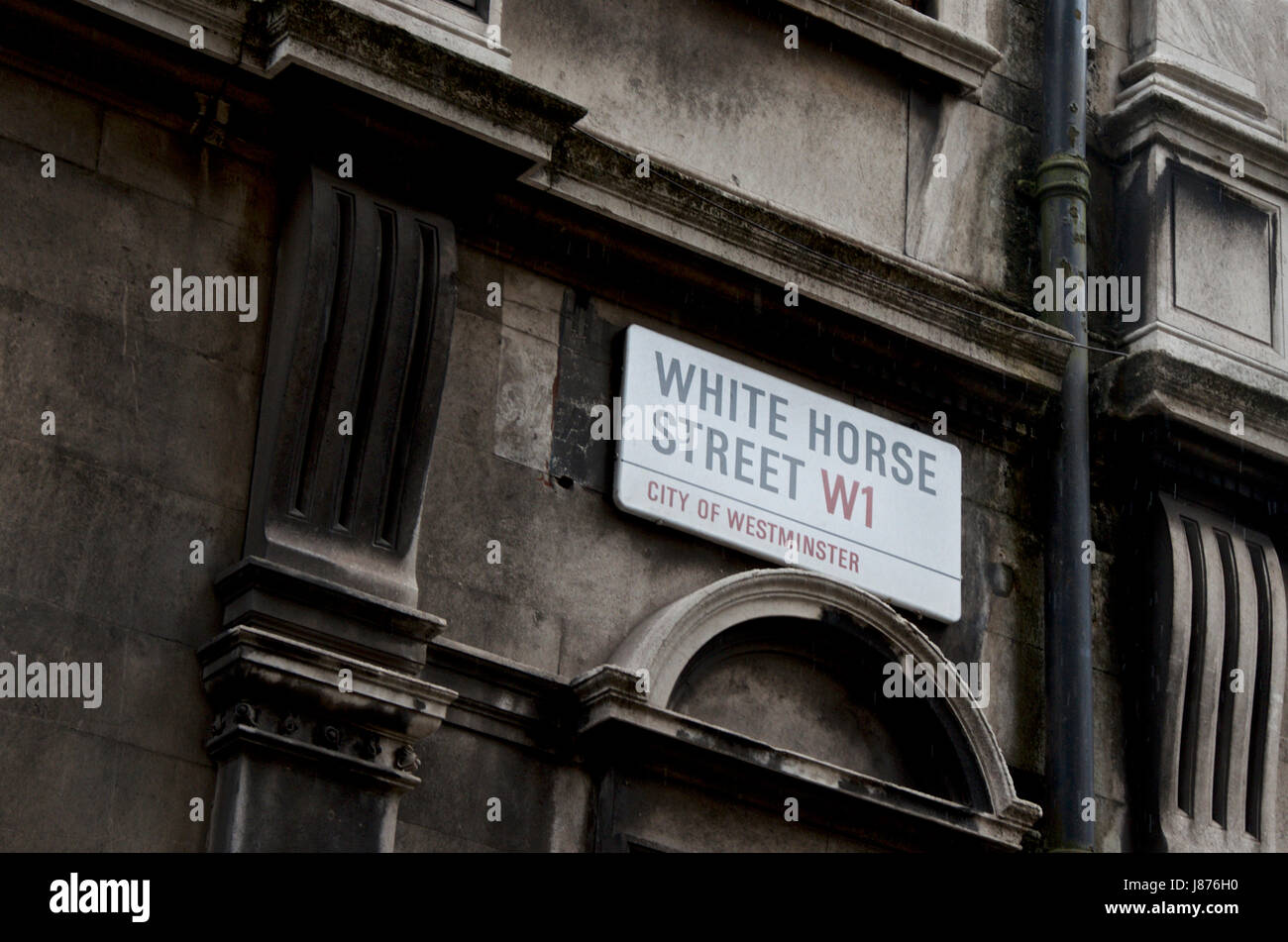 A London street sign, White Horse Street W1 on a dirty London building. - Stock Image