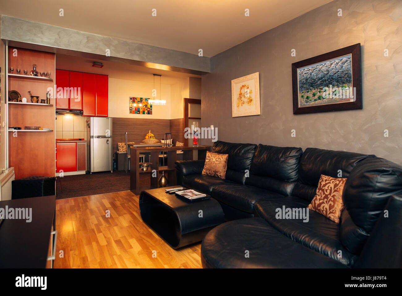 Commercial Office Paint Color Ideas, Black Leather Sofa In The Apartment Interior Living Room Stock Photo Alamy