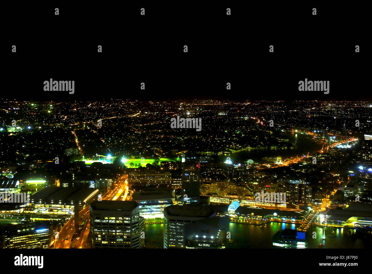 A night view of Sydney taken from the Sydney Eye and showing part of the harbour in the foreground. There is room - Stock Image
