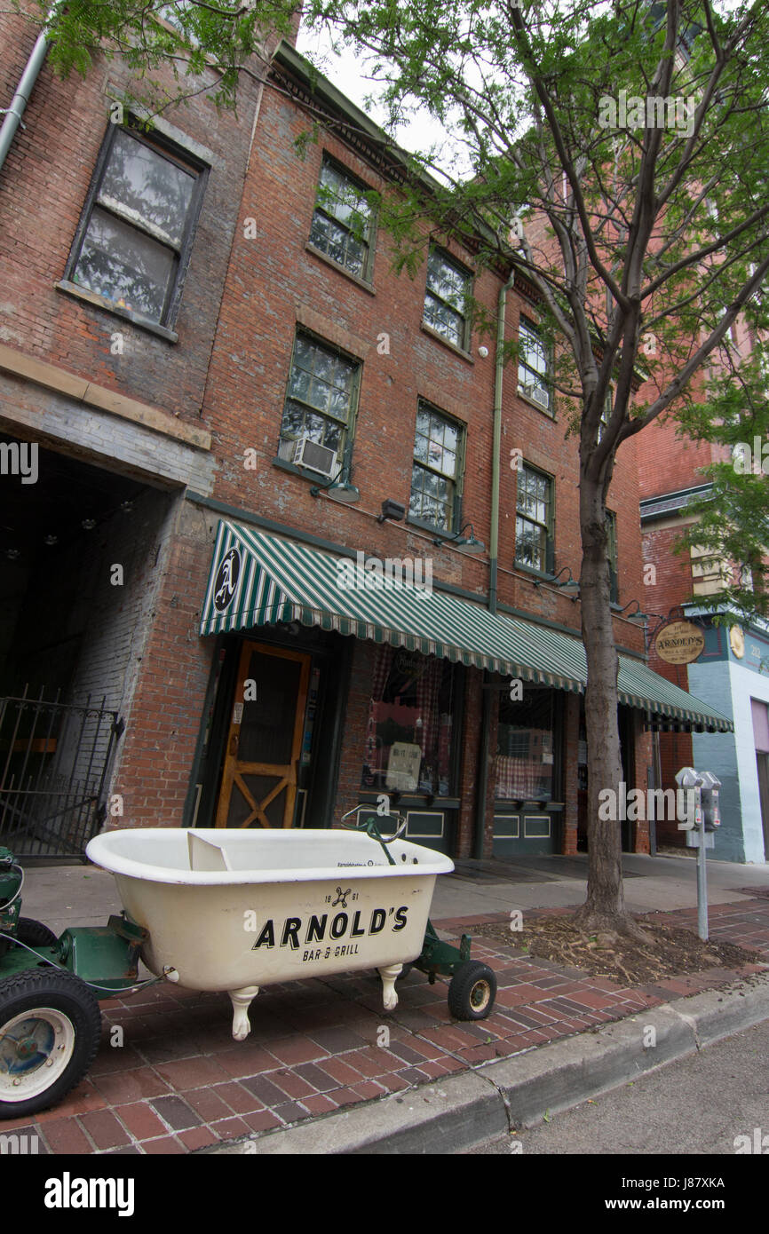 Image of Arnold's Bar with a bathtub out front that was used in making bathtub gin. - Stock Image