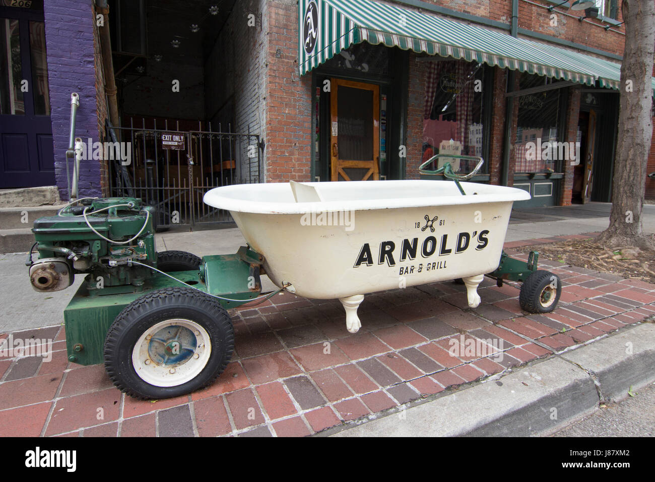 Image of Arnold\'s Bar with a bathtub out front that was used in ...
