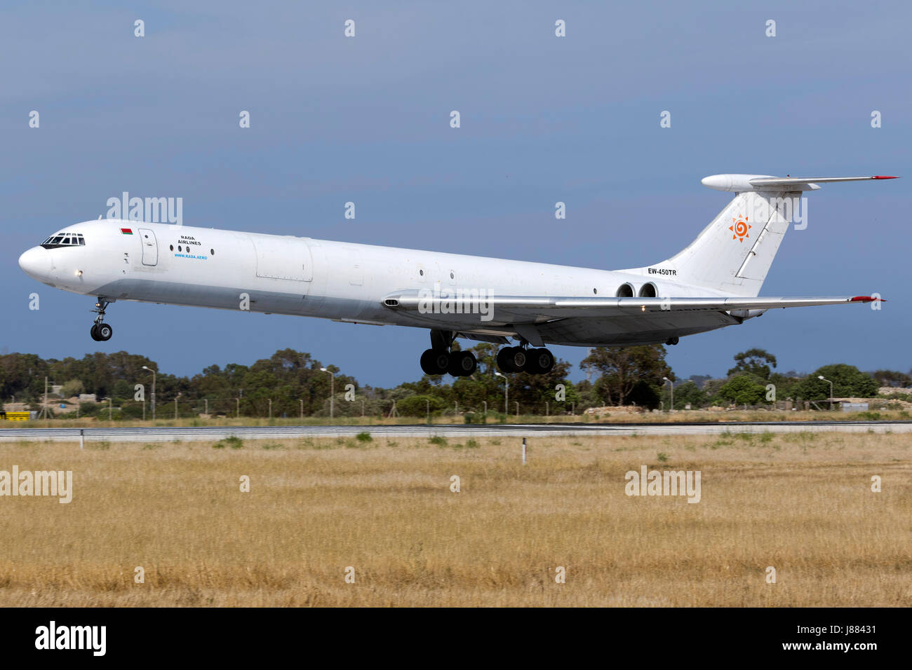 Rada Airlines Ilyushin Il-62MGr [EW-450TR] landing runway 31. This aircraft is extremely rare nowadays! - Stock Image