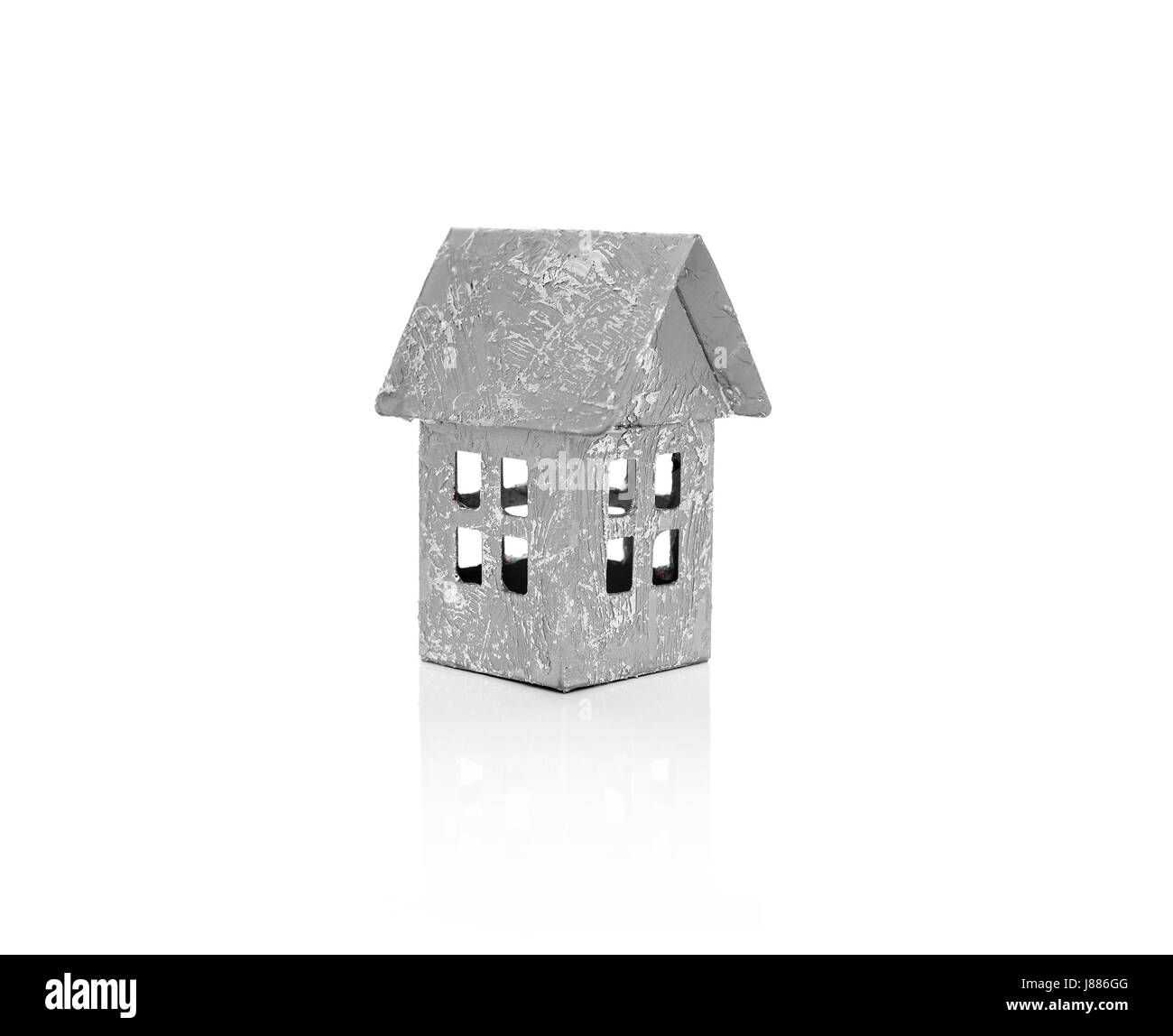 Model of a small house. Isolated on white background. - Stock Image