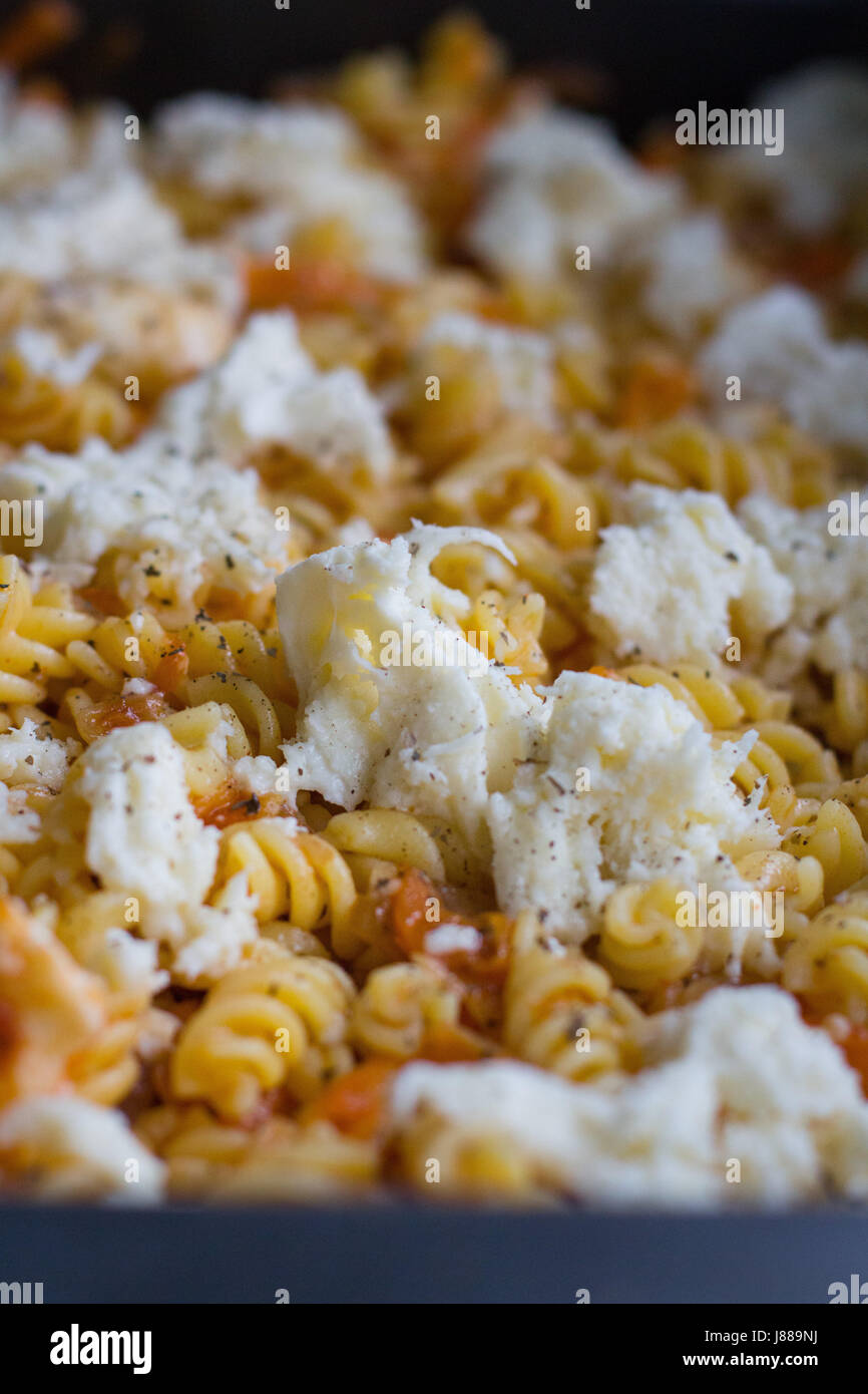 pasta dish before gratinated in the oven - Stock Image