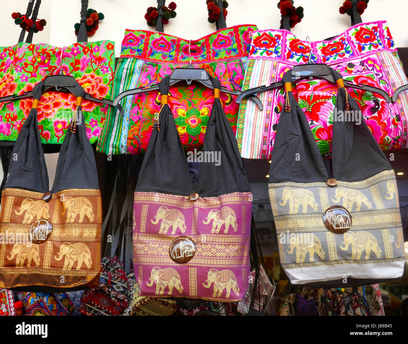 Cheerful bags on sale at Siem Reap, Cambodia - Stock Image