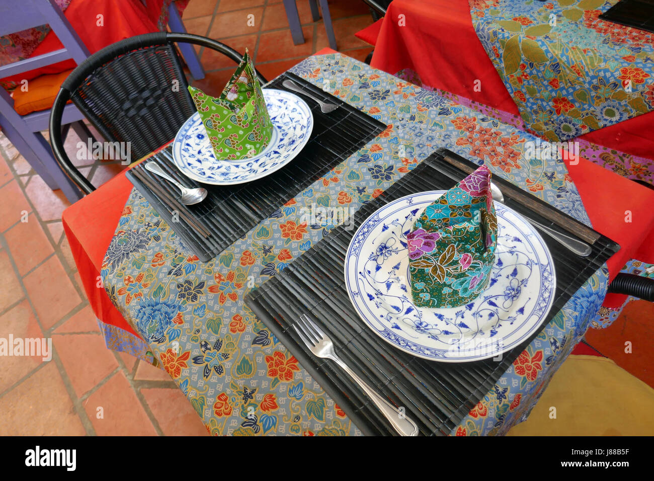 Bright restaurant table, Siem Reap, Cambodia - Stock Image