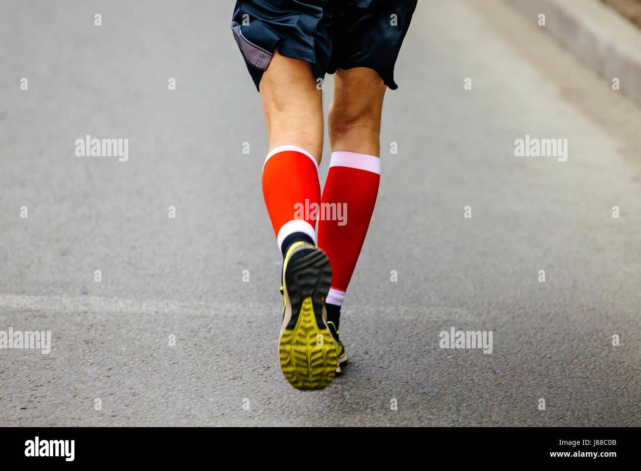 3566a62a9d back feet men runner in red compression socks running street Stock ...