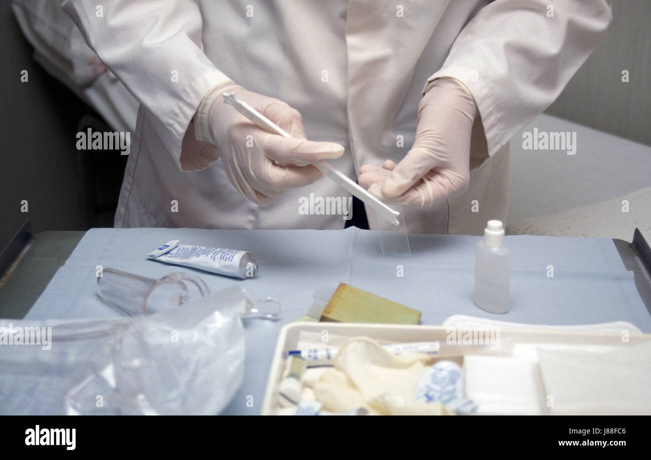 physician's hands preparing cervical smear test for laboratory - Stock Image