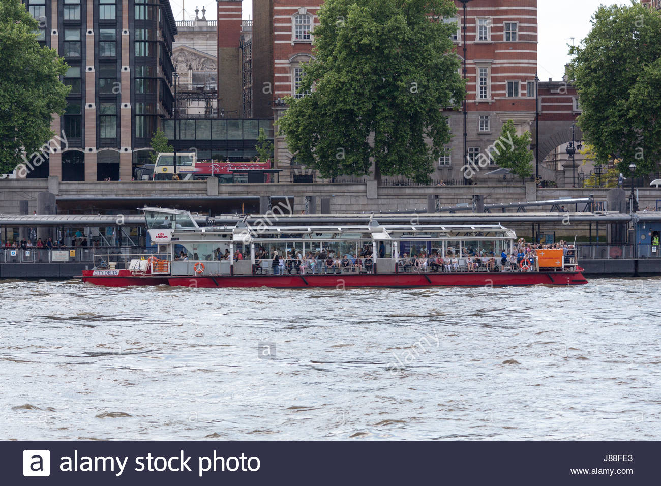 Passenger vessel City Delta of City Cruises docked at Westminster Pier - Stock Image