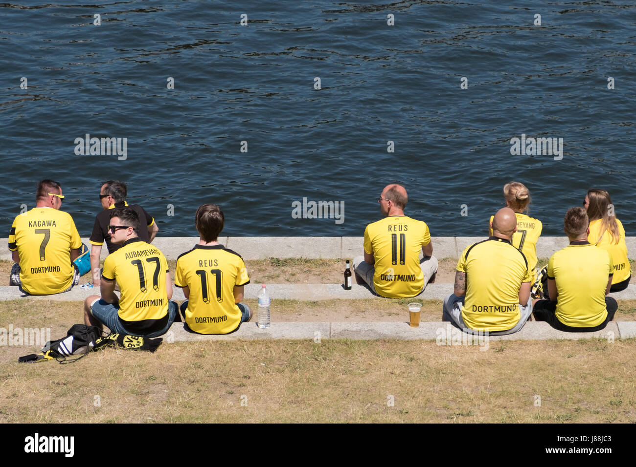 Berlin, Germany - may 27, 2017: BVB Fans / Borussia Dortmund Fans wearing tricots and sitting on river Spree in - Stock Image