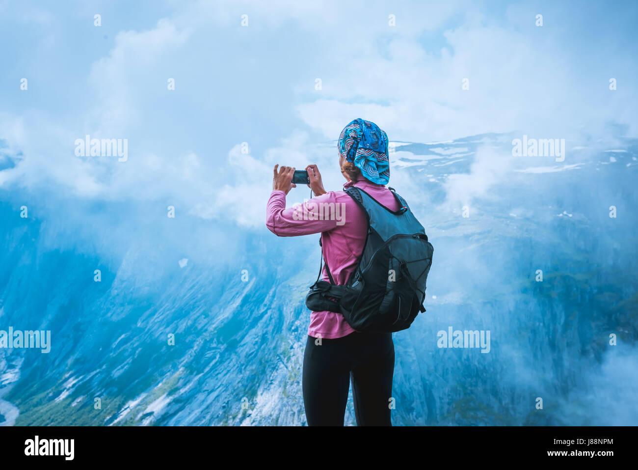 Nature photographer tourist near Norway lake - Stock Image