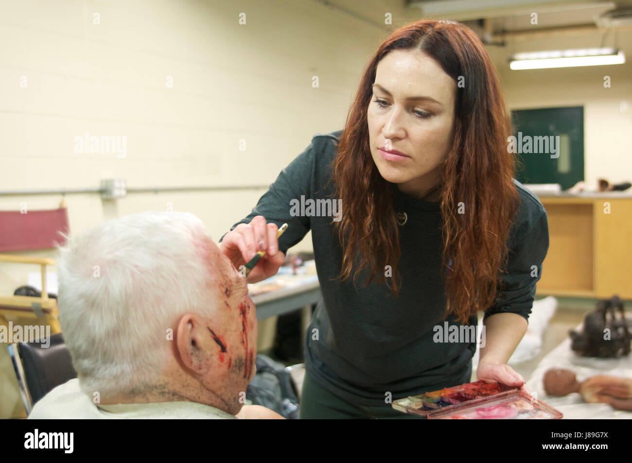 Special effects makeup artist Yvonne Cox applies prosthetic wounds to a role player who will act as a simluated castualty on a training mission as part of ...