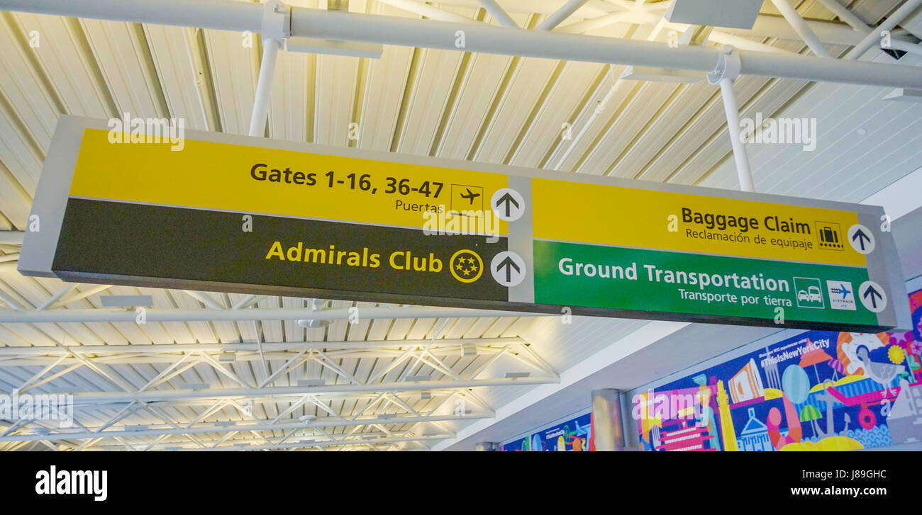 Direction signs at the airport for gates and baggage claim DALLAS - TEXAS - APRIL 10, 2017 - Stock Image