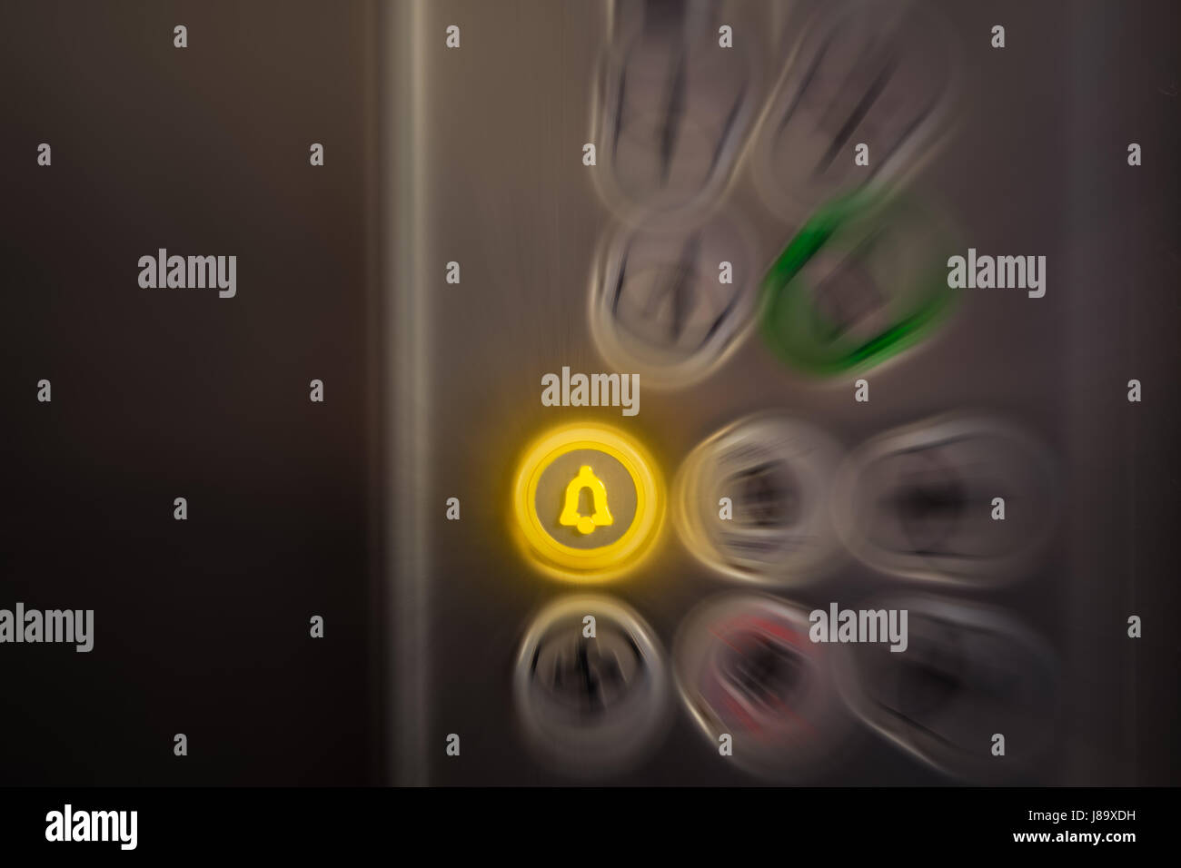 Close up of elevator alarm and panic button on control panel. Button is switched on. Emergency and call for help - Stock Image