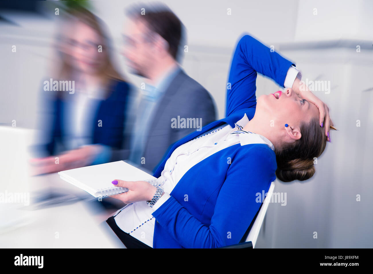 Young female professional does not agree with the opinion of her colleagues on a business meeting - Stock Image