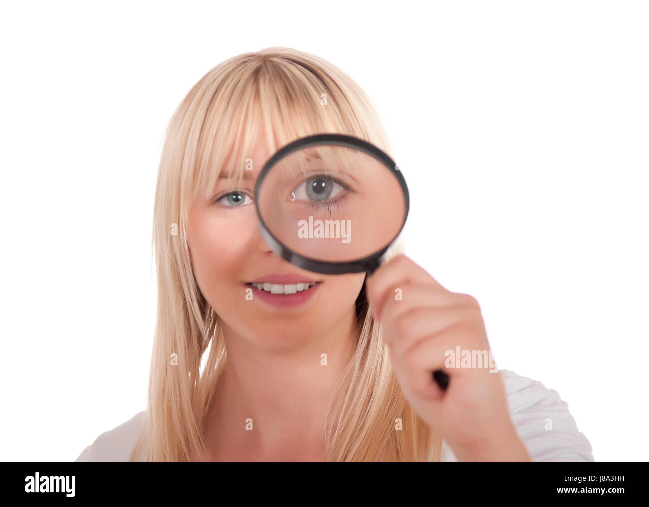 young blonde woman with magnifying glass Stock Photo