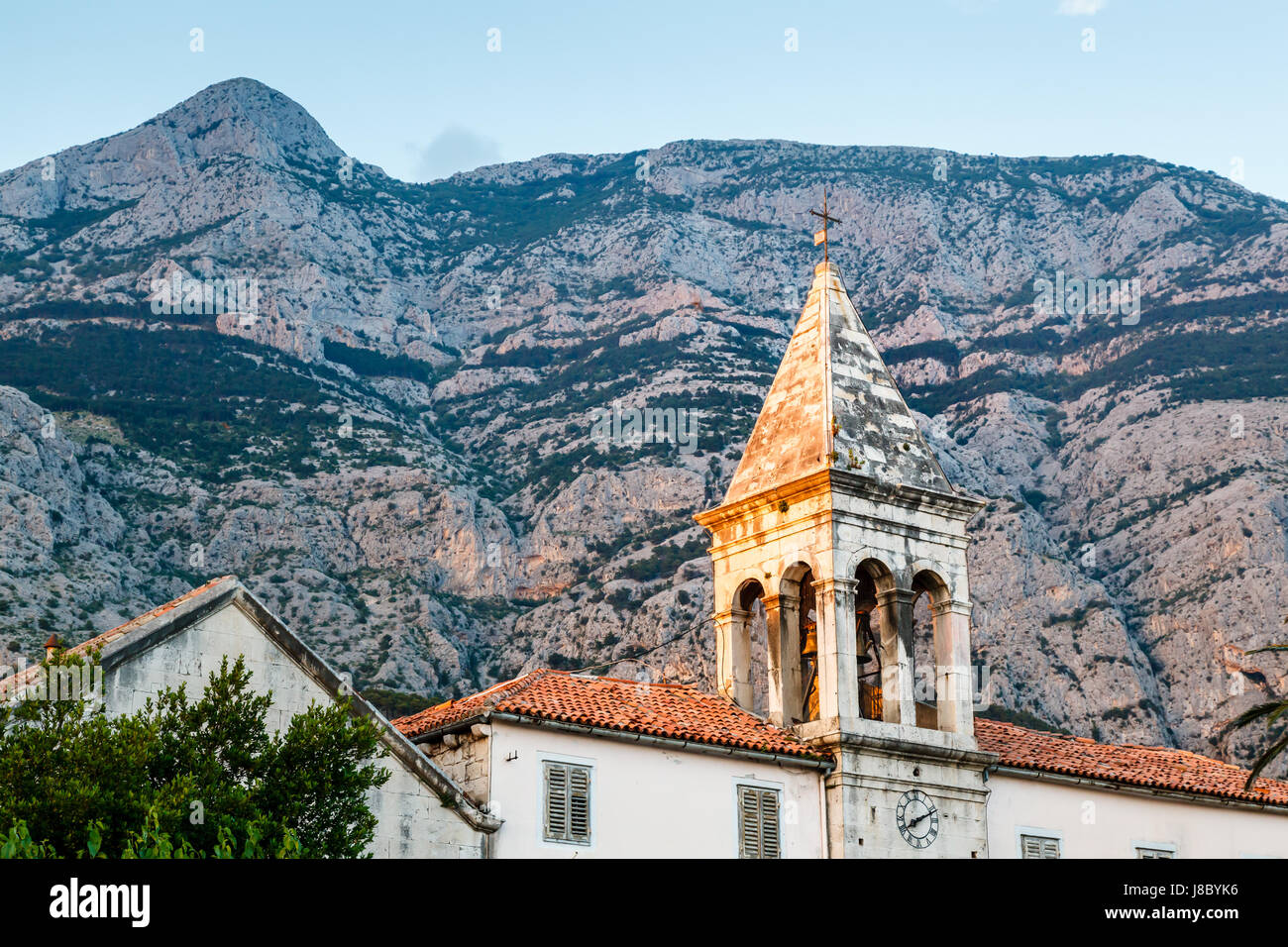 Medieval Bell Tower and Biokovo Mountains in the Background, Makarska, Croatia Stock Photo