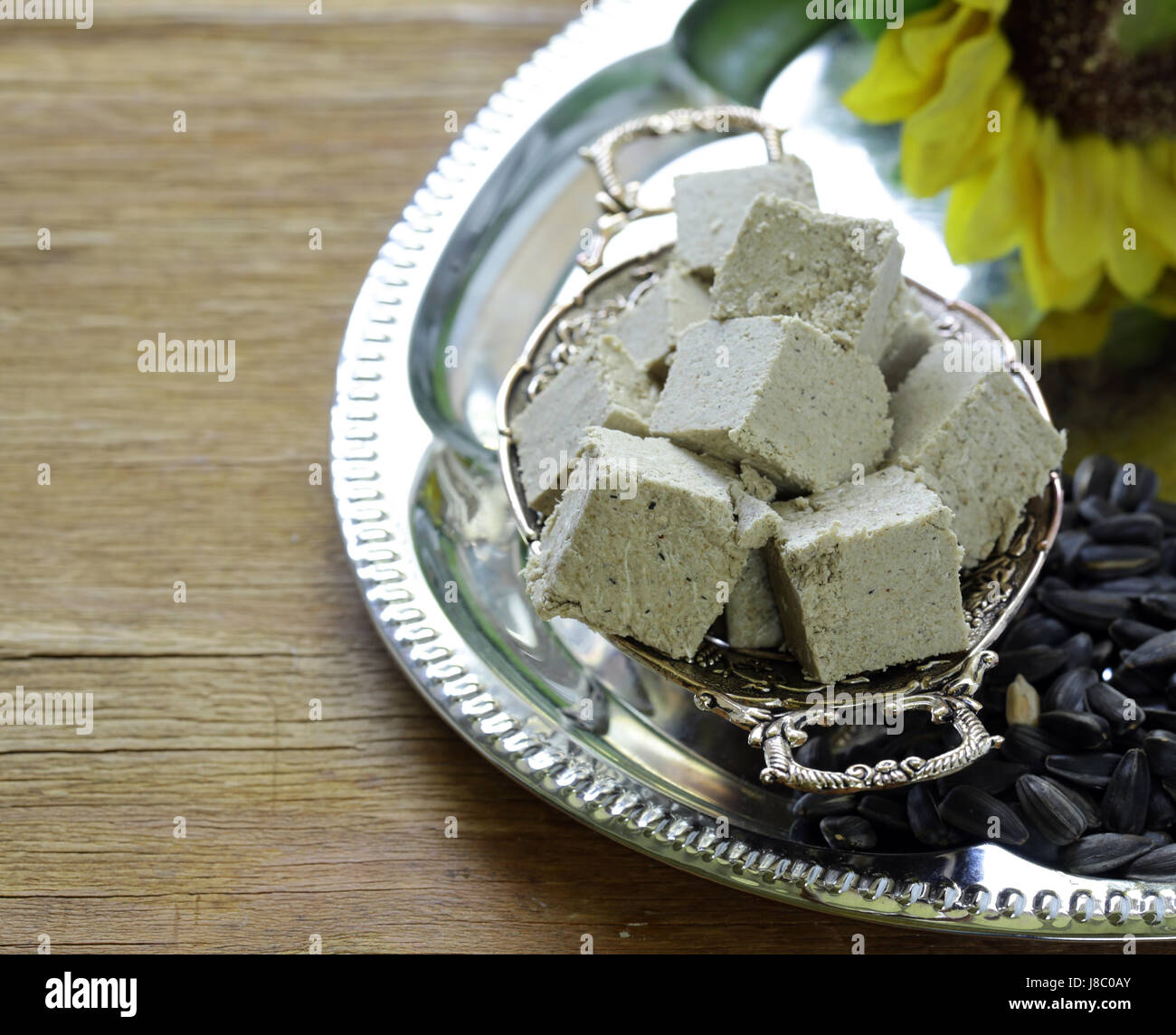 Oriental sweets halva from sunflower seeds with honey - Stock Image