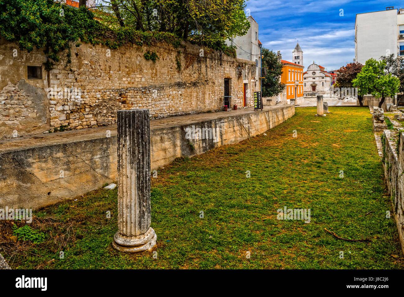 Dalmatia Zadar  roman forum and in background st. Mary's church - Stock Image