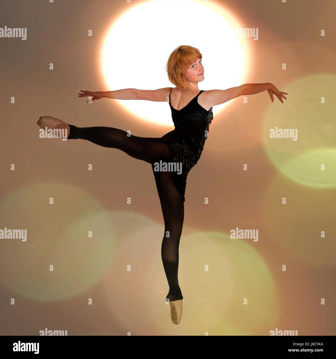 Female Ballet Dancer balances on her tows Digitally enhanced photograph - Stock Image