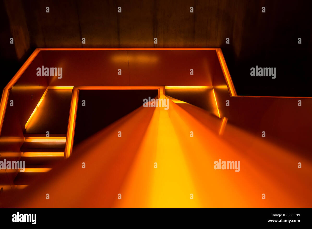 Illuminated staircase of the museum in the world heritage site 'Zeche Zollverein', a closed coke oven plant - Stock Image