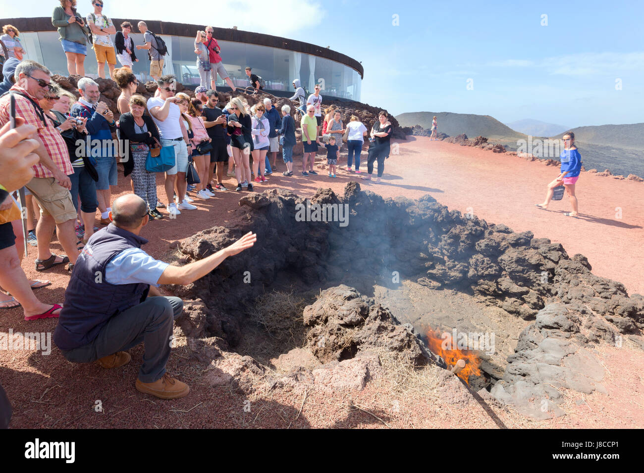 Lanzarote Timanfaya National Park - demonstration of volcanic activity to tourists, Timanfaya National Park, Lanzarote, - Stock Image