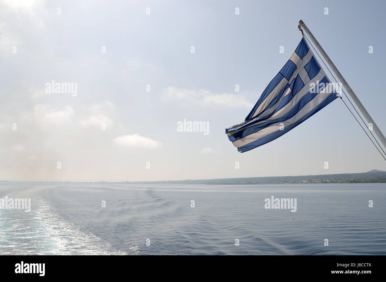 Wake of ferry boat and Greek flag - Stock Image