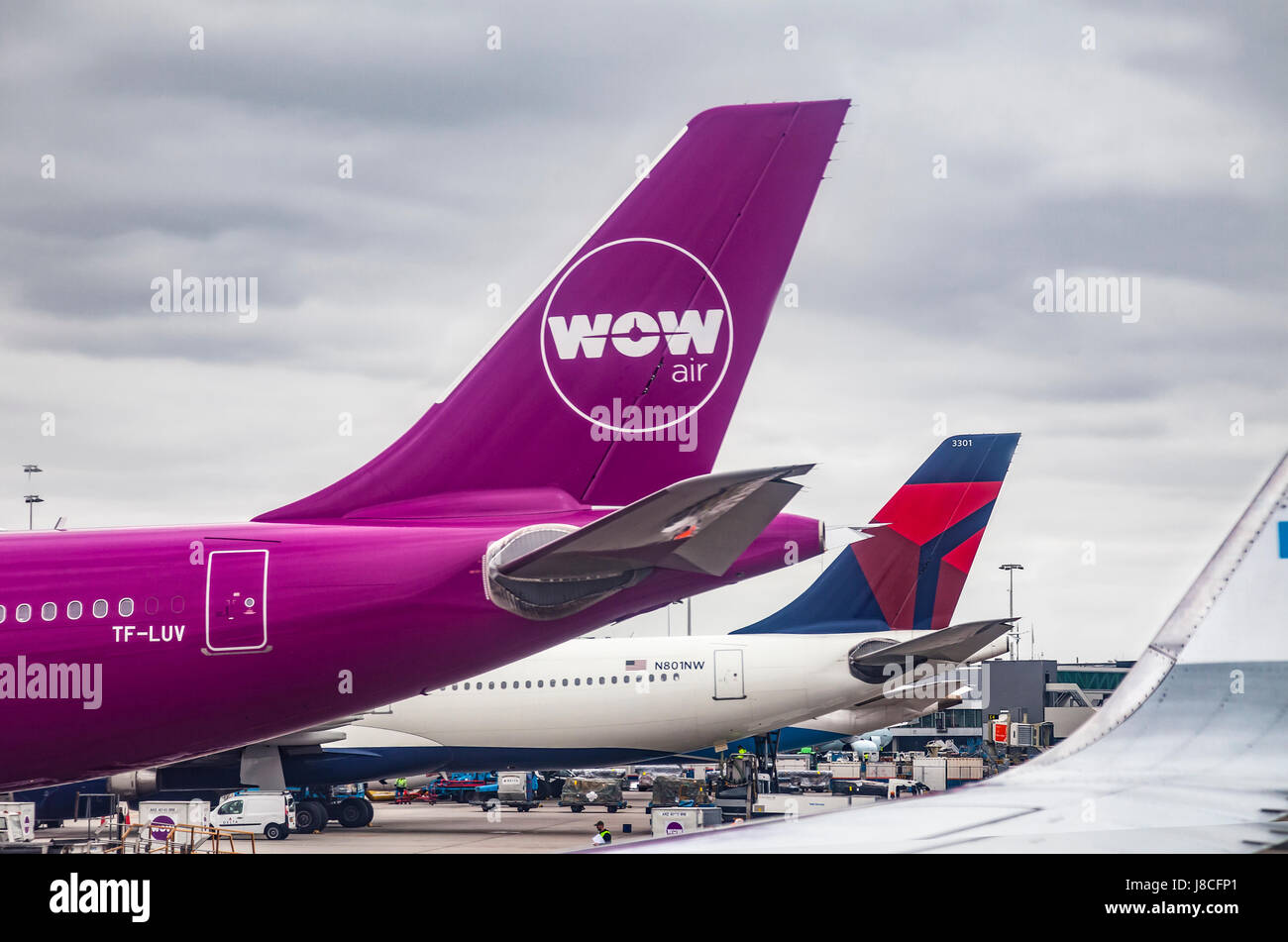 WOW air (budget Icelandic airline) Airbus A330-343 at Schiphol Airport. Delta Airlines Airbus A330-323 behind. Support - Stock Image