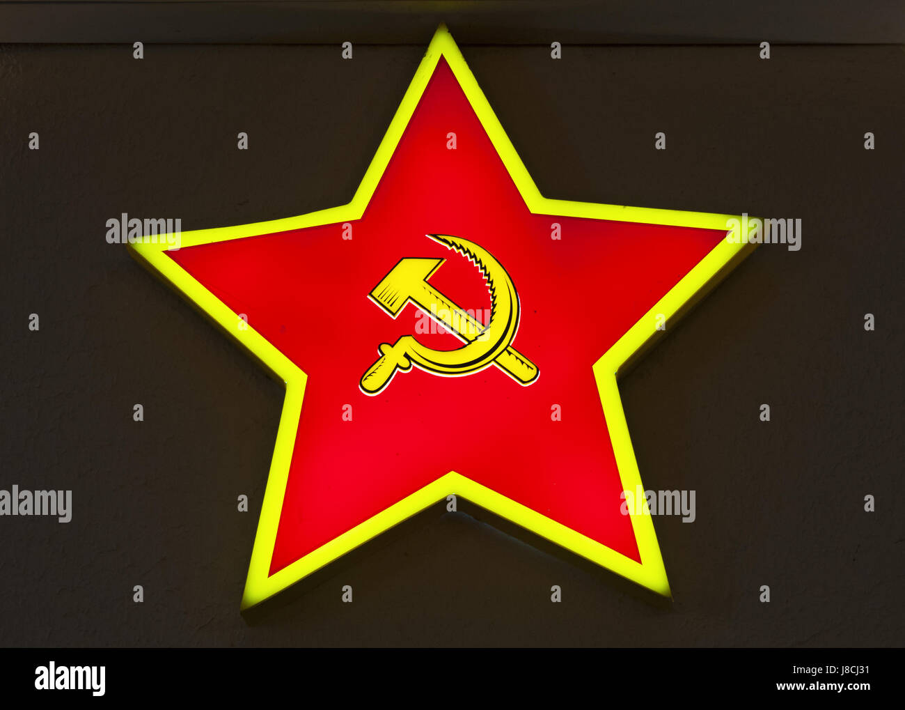 Moscow: a neon light in the shape of a star with the hammer and sickle inside seen at Bunker-42, anti-nuclear underground - Stock Image