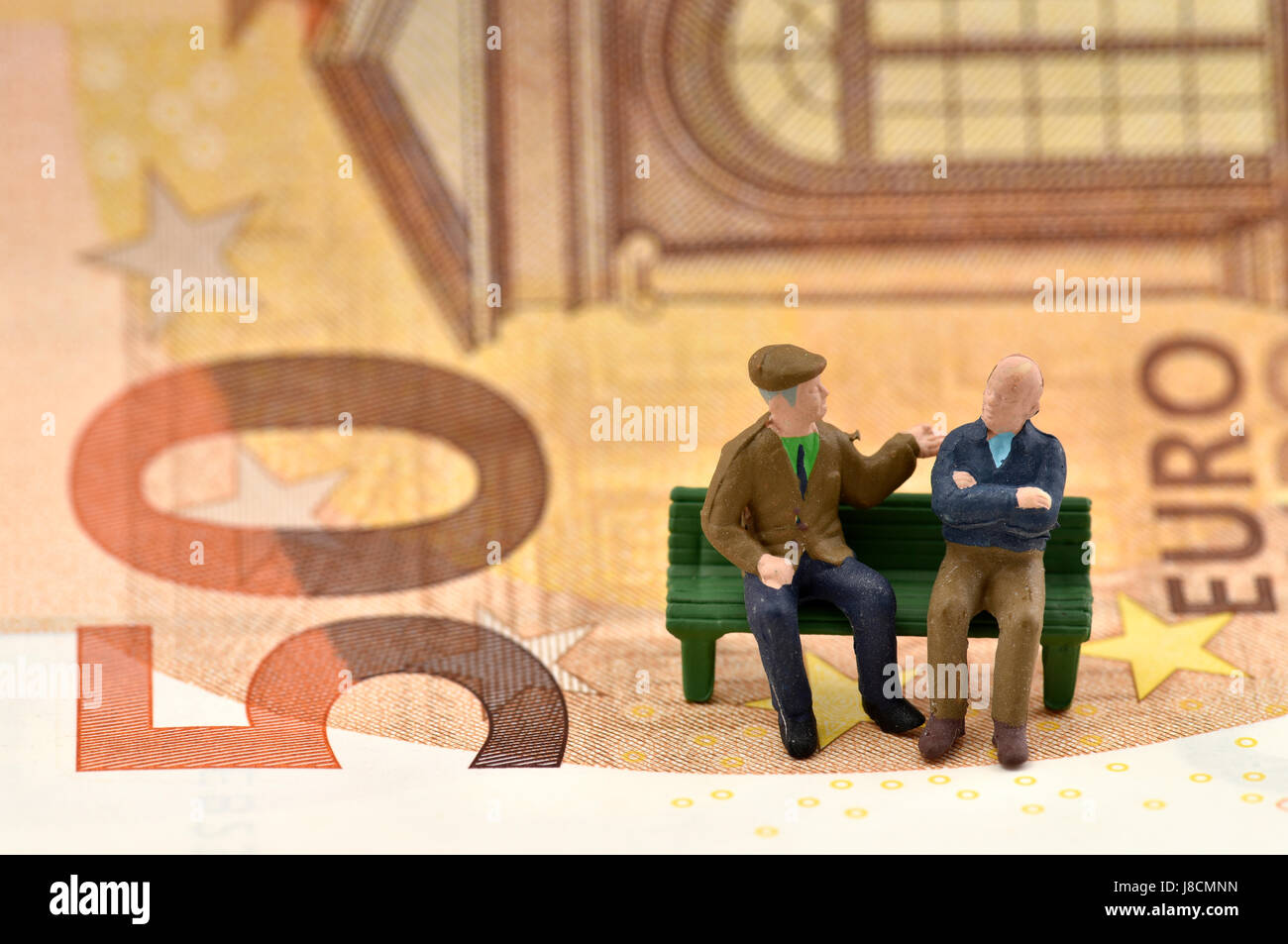 Symbolic image pension, pensioner, long-term care insurance, private and state provisions, bank notes, euro - Stock Image