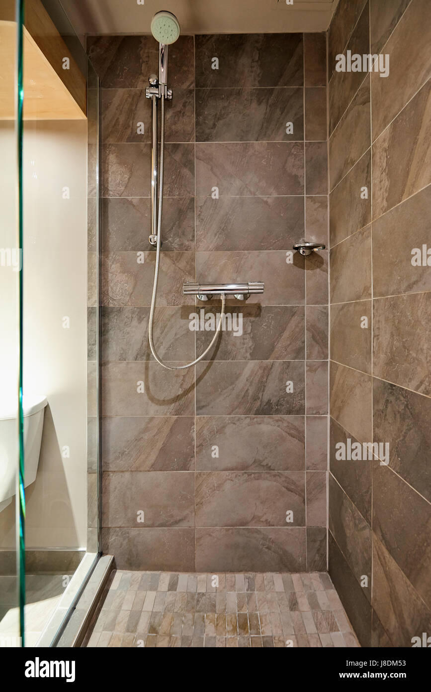 Rain shower bathroom stone tile background Stock Photo: 142901391 ...