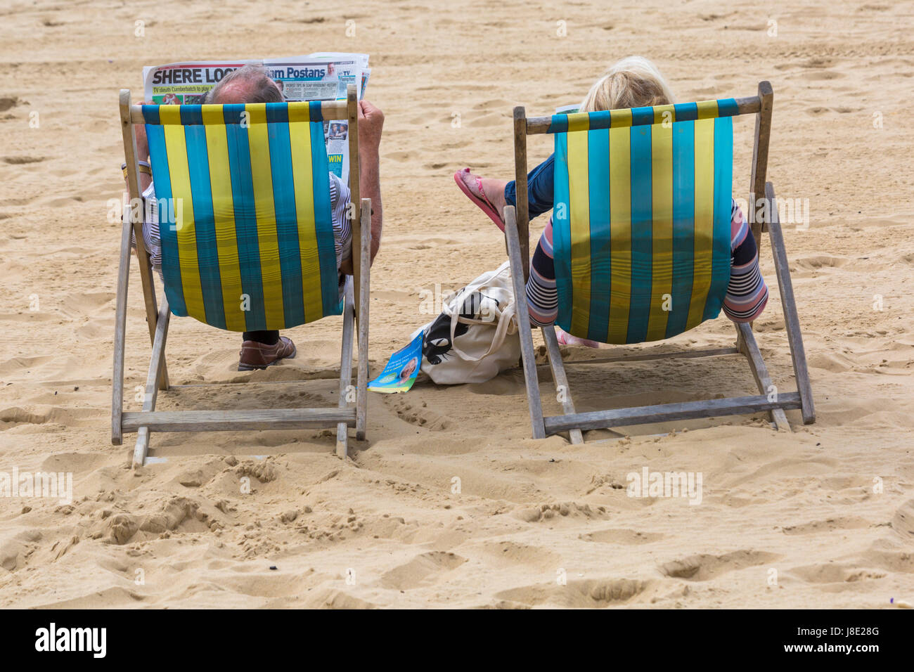 Bournemouth, Dorset, UK. 28th May, 2017. UK weather: overcast day at Bournemouth beaches, but the sun is trying to break through. Visitors head to the seaside to make the most of the Bank Holiday weekend. Couple in deckchairs on Bournemouth beach.  Credit: Carolyn Jenkins/Alamy Live News Stock Photo