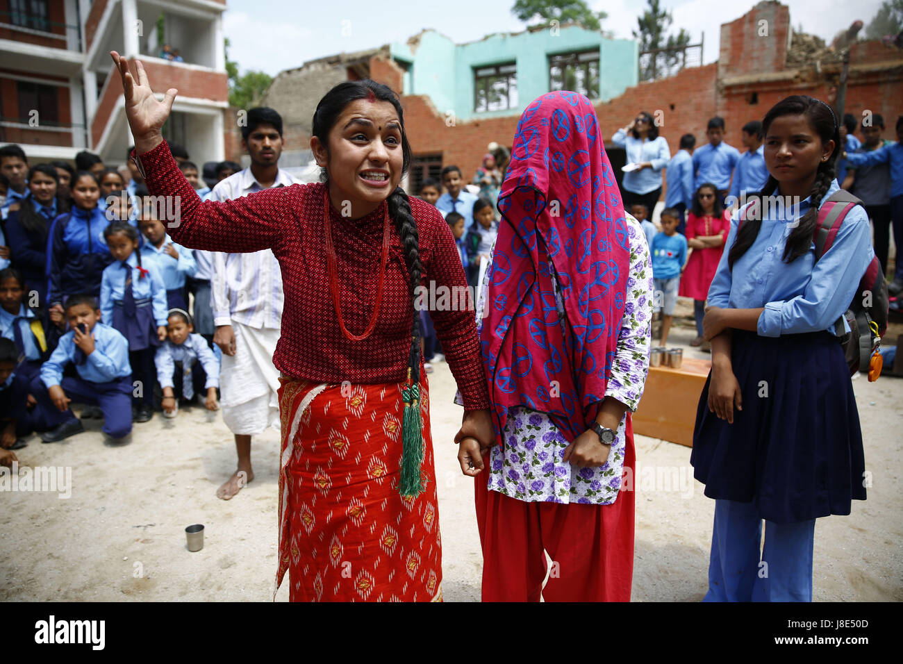 Bhaktapur, Nepal. 28th May, 2017. Nepalese artists stage an awareness drama at a school to mark Menstrual Hygiene - Stock Image