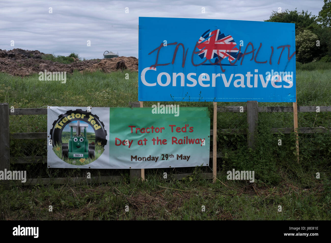 Wincanton, Somerset, UK. 28th May, 2017.  Defaced Tory election poster on side of road. Credit: Paul Chambers/Alamy - Stock Image