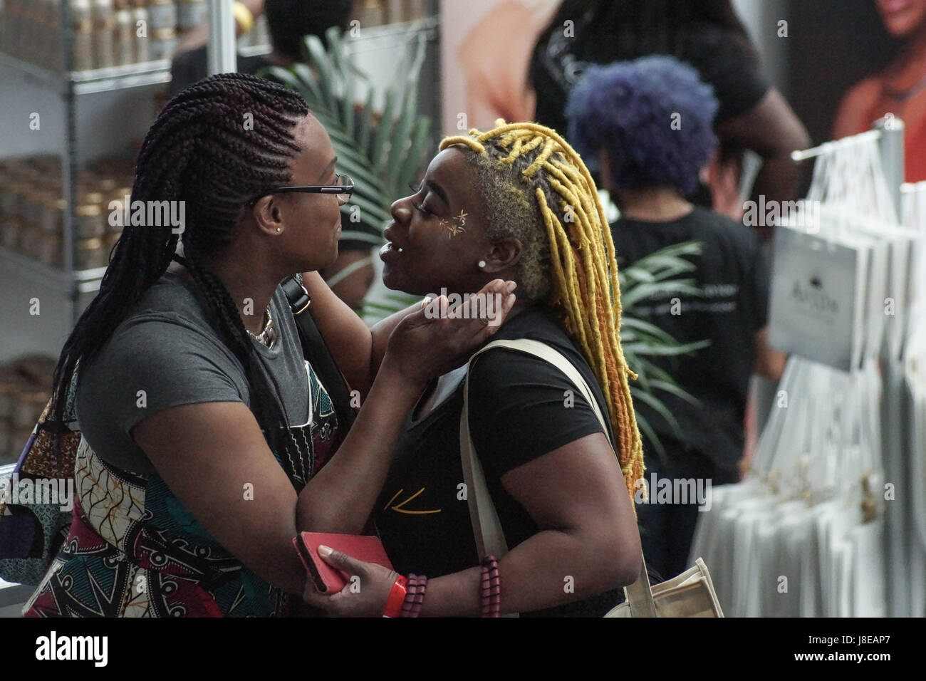 London, England 28 MAY  2017. AFRO HAIR & BEAUTY LIVE 28 MAY  2017.A chance encounter for two old friends.  - Stock Image