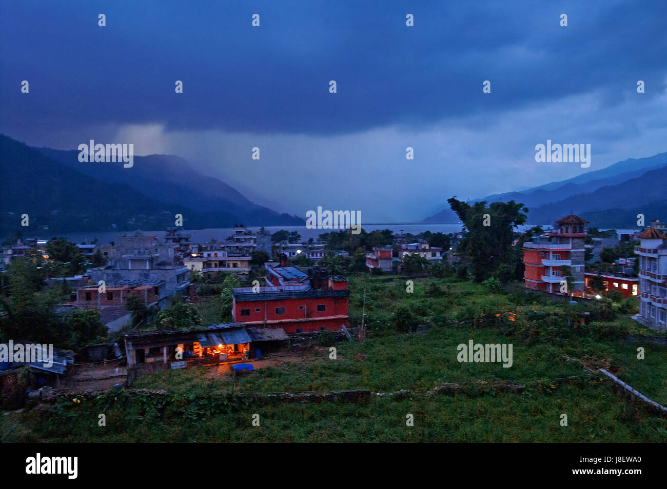 Pokhara and Lake Phewa in Nepal in the evening - Stock Image