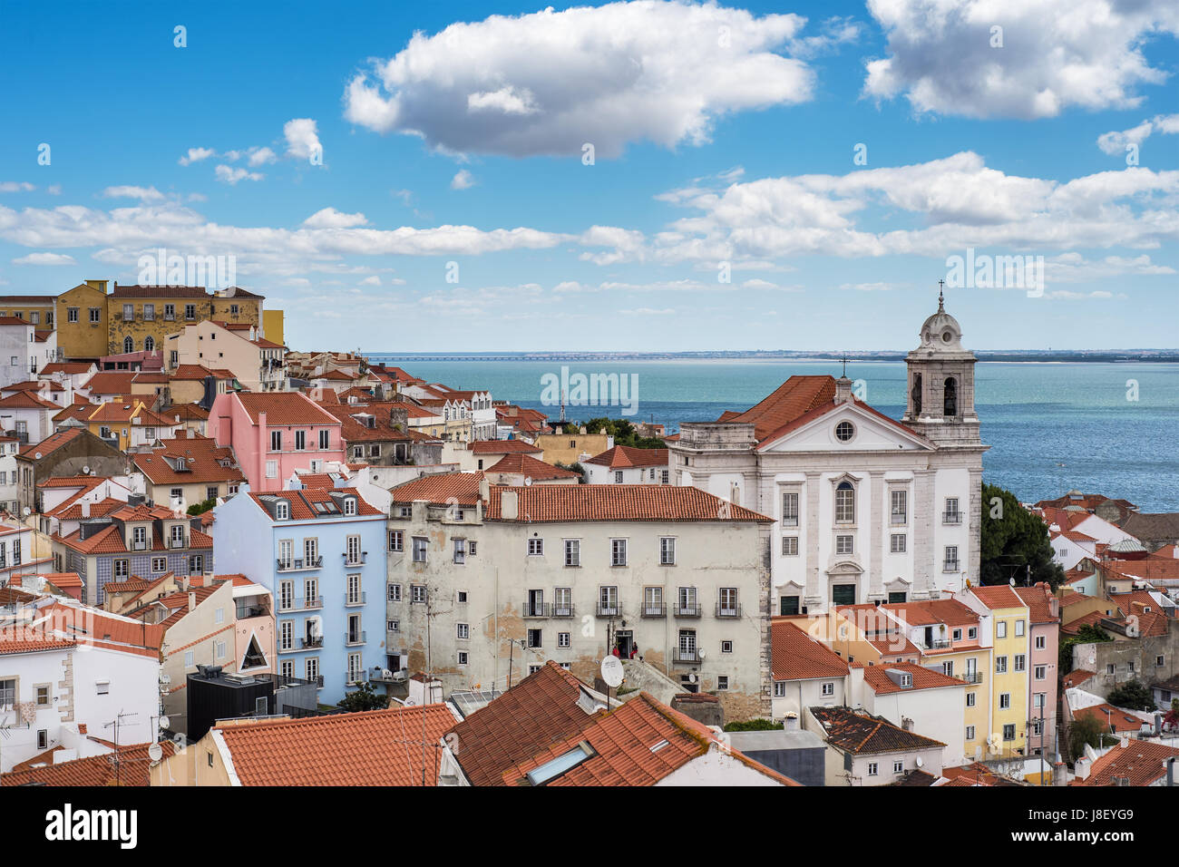 Aerial view of Lisbon city and Tagus River with red roofs and landmarks - Stock Image