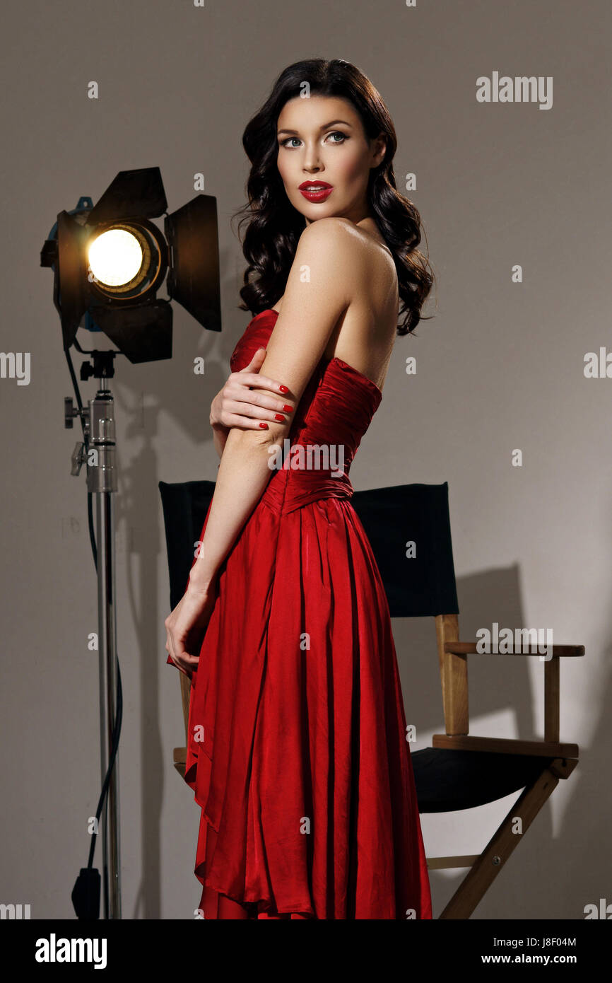 Young Pretty Beautiful Woman In Red Long Evening Dress With Makeup
