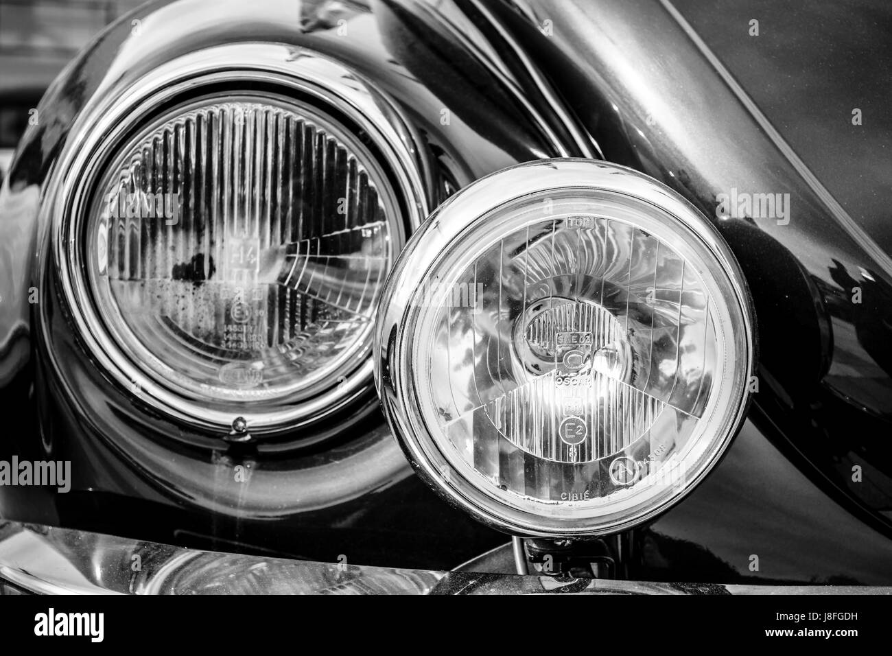 STUTTGART, GERMANY - MARCH 04, 2017: Headlamp of a compact car Volkswagen Beetle Cabrio, 1976. Close-up. Black and - Stock Image