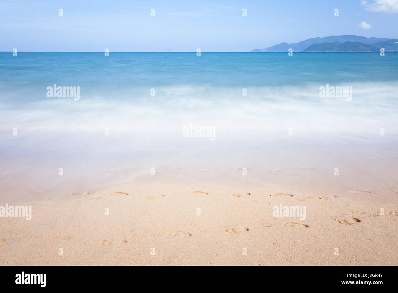 Blurred sea waves motion, Nha Trang, Vietnam. - Stock Image