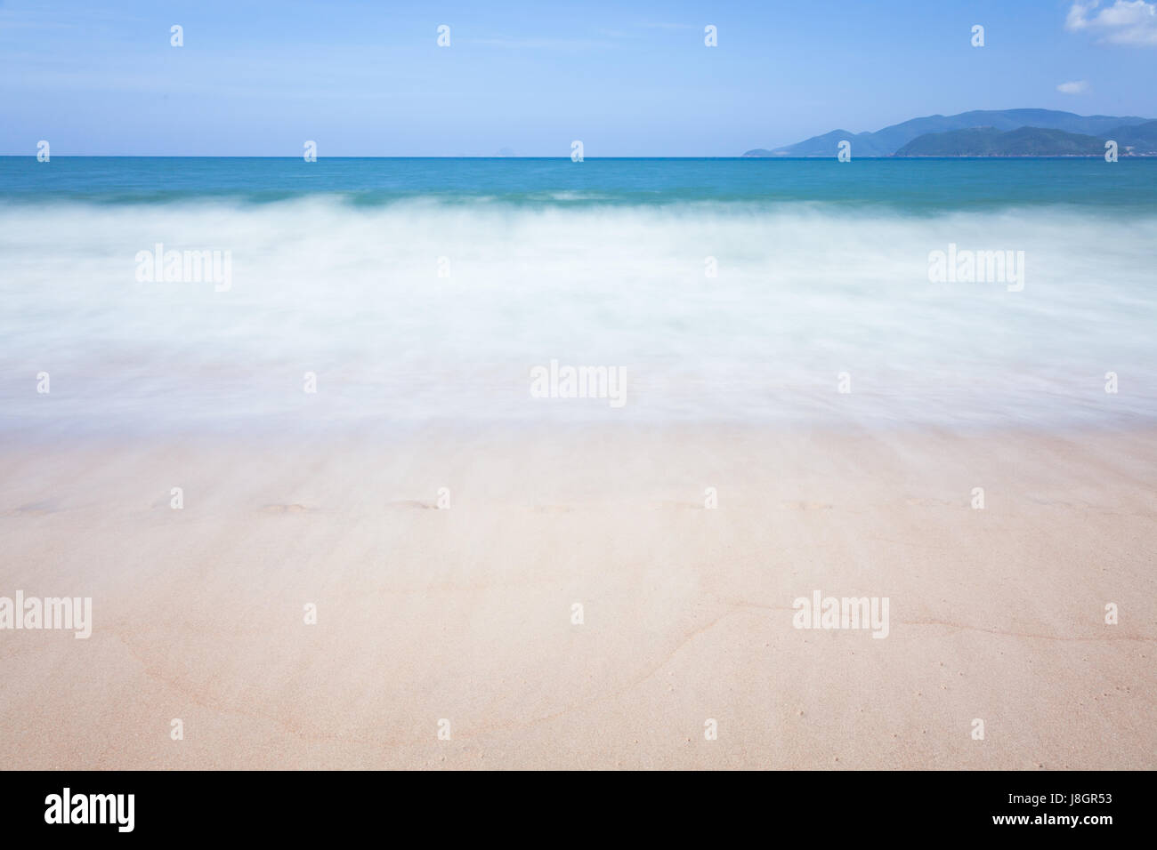 Blurred sea waves motion, Nha Trang, Vietnam. Stock Photo