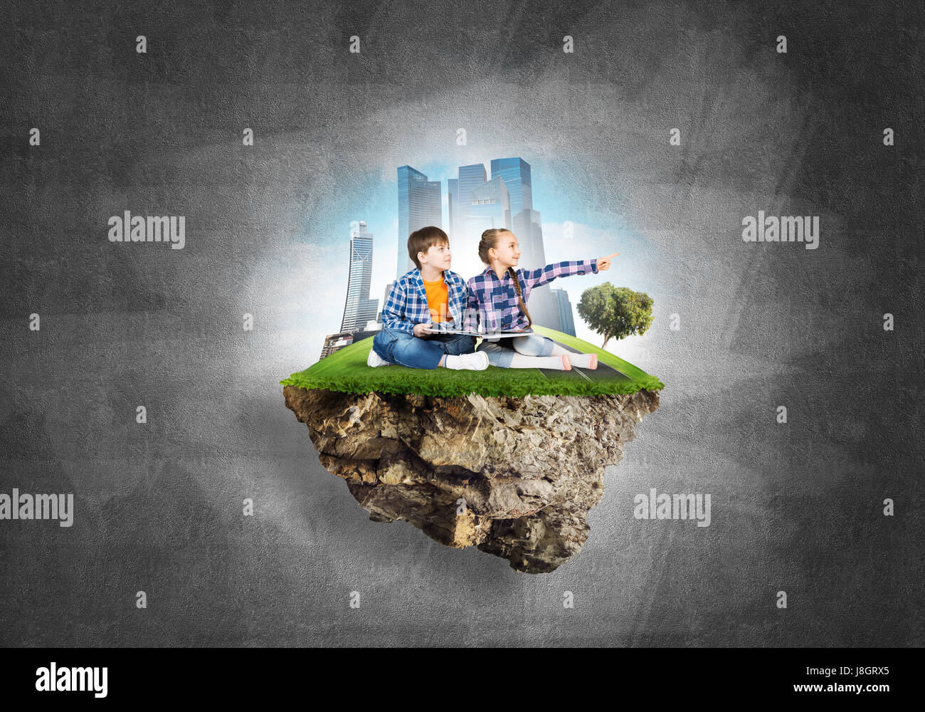 Two kids of school age with book exploring this great world - Stock Image