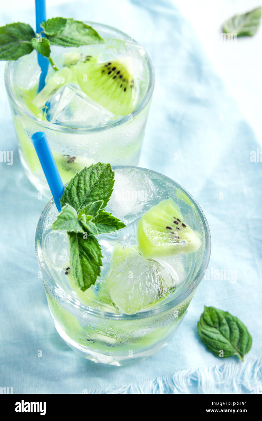 Kiwi drink (cocktail) with mint and ice in glasses close up. Cold summer drink. - Stock Image